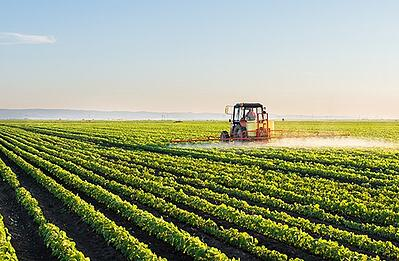 Tractor spraying plant protection product onto field