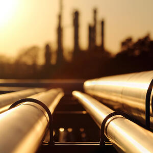 Industrial chemical factory pipes at sunset K-REACH